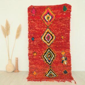 Tapis berbère Marocain en pure laine rouge et motifs colorés